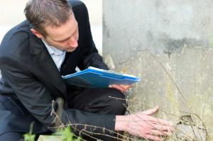 Businessman Examining Wall