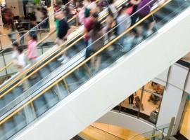 consumer shop buy mall store escalator crowd shopping