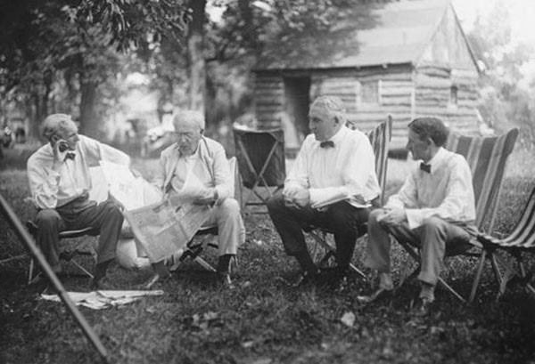51. Henry Ford, Thomas Edison, Warren G. Harding (29th president of USA ), and Harvey Samuel Firestone talking together
