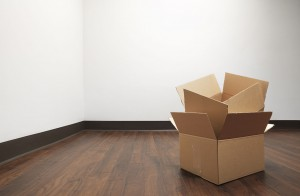 Boxes for house move empty room - Stock Image