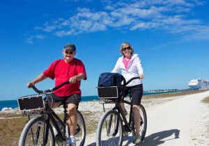 retire baby boomer leisure exercise sun bike beach elderly old couple