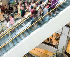 consumer shop buy mall store escalator crowd shopping