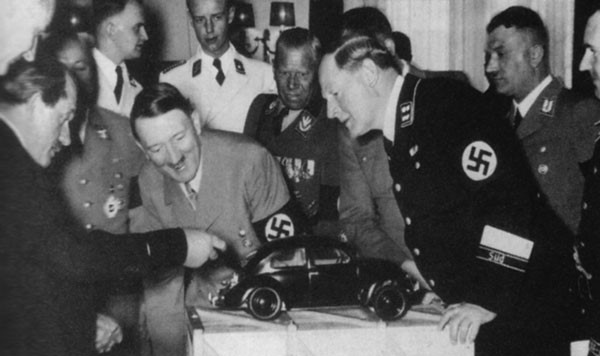 46. Ferdinand Porsche (yeah, that Porsche) showing a model of the Volkswagen Beetle to Adolf Hitler in 1935