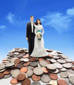 wedding couple on coins - money concept