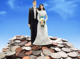 wedding couple on coins - money concept