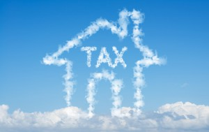 Cloud house of tax concept on blue sky