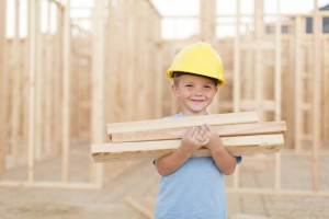 Young Boy Dressed As Carpenter With Hardhat And Tools