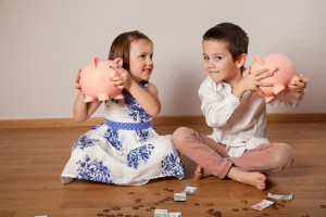 Children Holding Their Piggy Bank