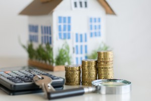 Mortgage Concept Focused On The Coins And Keys