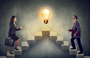Business People Climbing A Flight Of Stairs, Stepping Up A Stairway Career Ladder With Idea Light Bulb On A Top