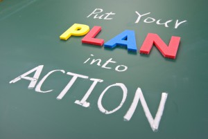 Put Your Plan Into Action, Words On Blackboard