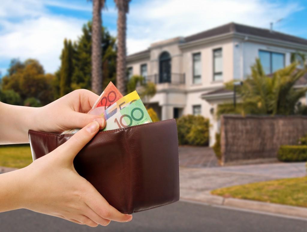 Australian Money In Wallet On Real Estate Background