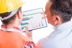 Contractor And Foreman Checking Financial Charts