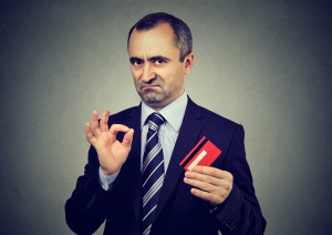 Sly Liar Businessman Employee Reassuring Their Credit Card Is The Best